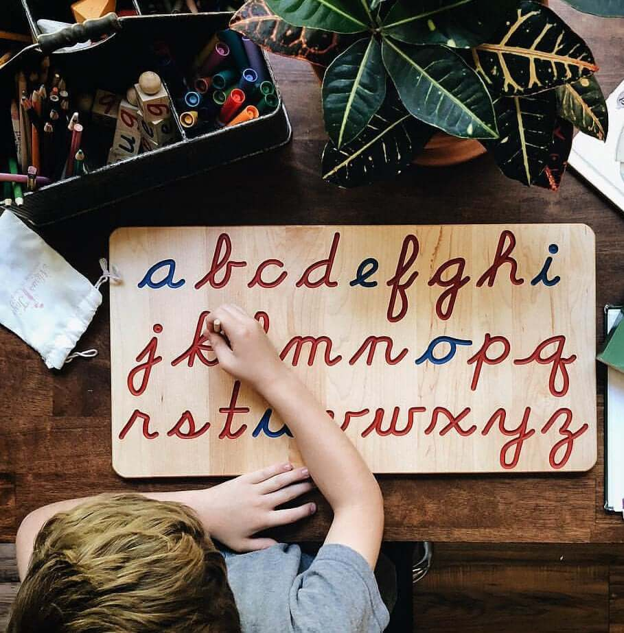 cursive writing wooden board